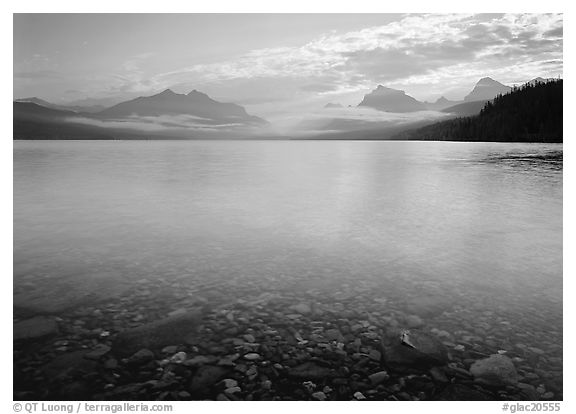 Lake McDonald with clouds reflected in early morning. Glacier National Park (black and white)