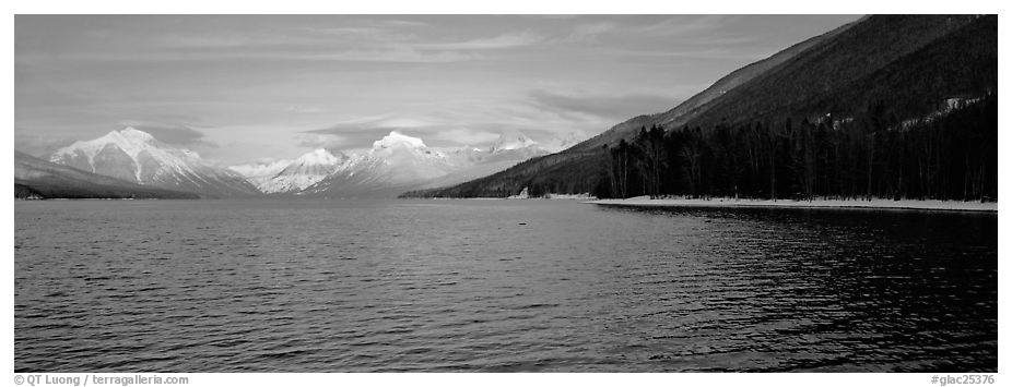 Snowy mountains across Mc Donald Lake. Glacier National Park (black and white)