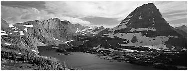 Alpine lake and triangular peak. Glacier National Park (Panoramic black and white)