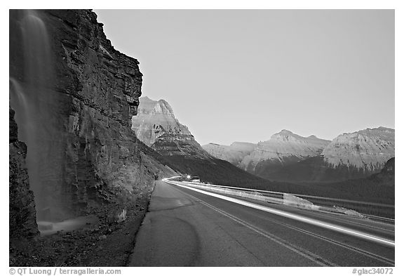 Roadside waterfall and light trail, Going-to-the-Sun road. Glacier National Park (black and white)