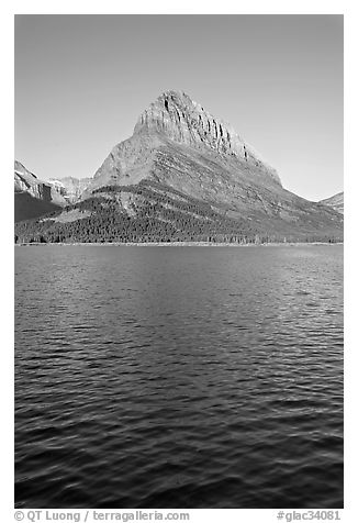 Grinnell Point across Swiftcurrent Lake, sunrise. Glacier National Park (black and white)