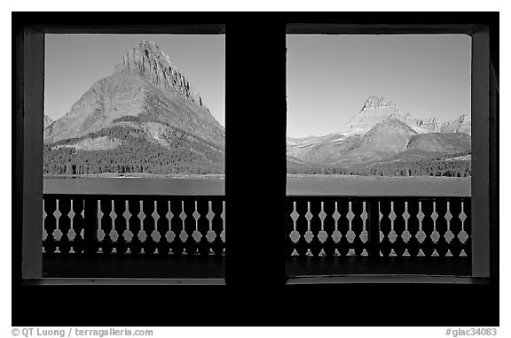 Grinnell Point and Swiftcurrent Lake framed by windows of Many Glacier Lodge. Glacier National Park (black and white)