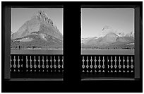 Grinnell Point and Swiftcurrent Lake framed by windows of Many Glacier Lodge. Glacier National Park ( black and white)