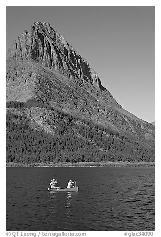 Red canoe on Swiftcurrent Lake. Glacier National Park (black and white)