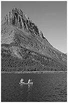 Red canoe on Swiftcurrent Lake. Glacier National Park ( black and white)