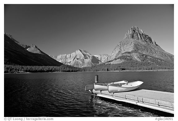 Deck and small boats on Swiftcurrent Lake. Glacier National Park (black and white)