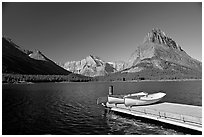 Deck and small boats on Swiftcurrent Lake. Glacier National Park, Montana, USA. (black and white)