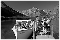 Passengers embarking on tour boat at the end of Lake Josephine. Glacier National Park, Montana, USA. (black and white)
