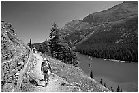 Hikers on trail above Lake Josephine. Glacier National Park, Montana, USA. (black and white)