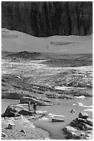 Crossing the outlet stream of the Grinnell glacial lake. Glacier National Park ( black and white)