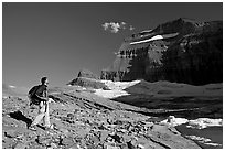 Hiker on moraine near Grinnell Glacier. Glacier National Park ( black and white)