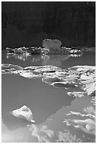 Garden wall reflection and icebergs in Upper Grinnell Lake. Glacier National Park ( black and white)