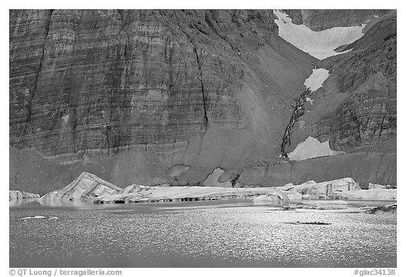 Ripples on Upper Grinnel Lake, with icebergs and glacier. Glacier National Park (black and white)