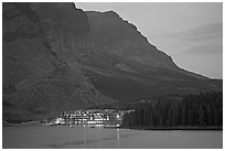 Swiftcurrent Lake and Many Glacier Lodge lights at dusk. Glacier National Park, Montana, USA. (black and white)
