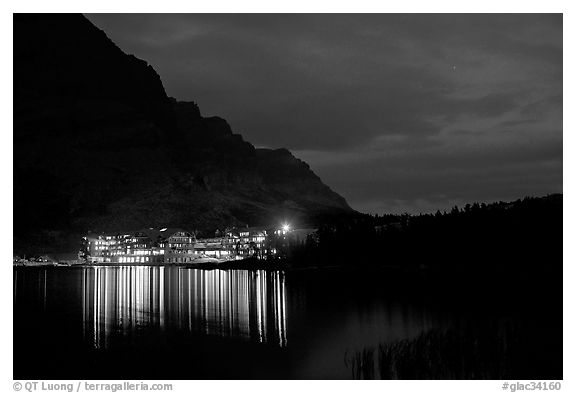 Many Glacier lodge lights reflected in Swiftcurrent Lake at night. Glacier National Park (black and white)