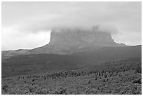 Chief Mountain, with top in the clouds. Glacier National Park, Montana, USA. (black and white)