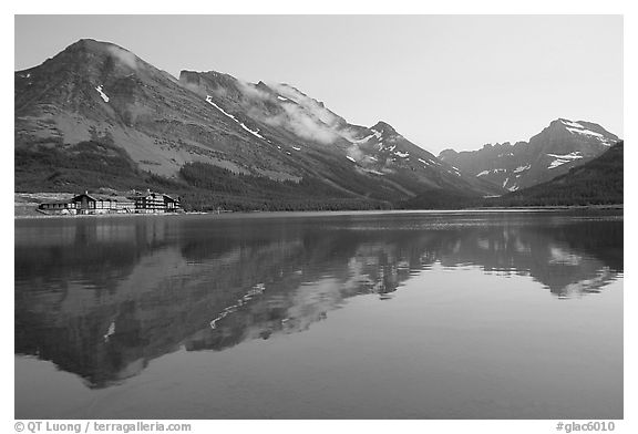 Many Glacier Hotel reflected in Swiftcurrent Lake. Glacier National Park (black and white)