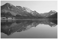 Many Glacier Hotel reflected in Swiftcurrent Lake. Glacier National Park, Montana, USA. (black and white)