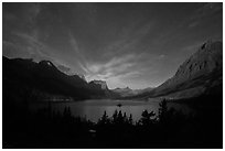 Saint Mary Lake at night with light from rising moon. Glacier National Park ( black and white)
