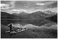 Kayaker readying gear, Kintla Lake. Glacier National Park ( black and white)