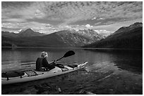 Kayaker paddles away from shore, Kintla Lake. Glacier National Park ( black and white)