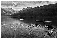 Four kayakers on Kintla Lake. Glacier National Park ( black and white)