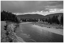 Dark clouds over North Fork of Flathead River in autumn. Glacier National Park ( black and white)