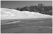 Mendonca creek, dunes and Sangre de Christo mountains. Great Sand Dunes National Park, Colorado, USA. (black and white)