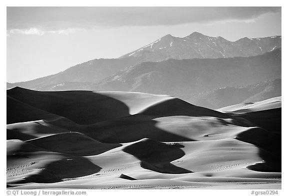Distant view of dunes and Sangre de Christo mountains in late afternoon. Great Sand Dunes National Park, Colorado, USA.