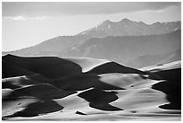 Distant view of dunes and Sangre de Christo mountains in late afternoon. Great Sand Dunes National Park, Colorado, USA. (black and white)