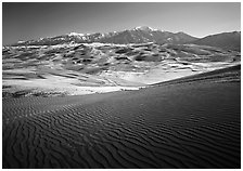 Rippled dunes and Sangre de Christo mountains in winter. Great Sand Dunes National Park ( black and white)