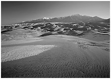 Sand dunes with snow patches and Sangre de Christo range. Great Sand Dunes National Park, Colorado, USA. (black and white)