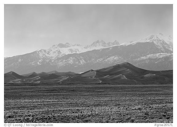 Flats, sand dunes, and snowy Sangre de Christo mountains. Great Sand Dunes National Park and Preserve (black and white)