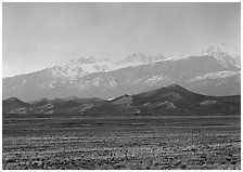Flats, sand dunes, and snowy Sangre de Christo mountains. Great Sand Dunes National Park, Colorado, USA. (black and white)