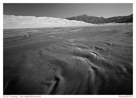 Medano creek with shifting sands, dunes and Sangre de Christo mountains. Great Sand Dunes National Park and Preserve (black and white)