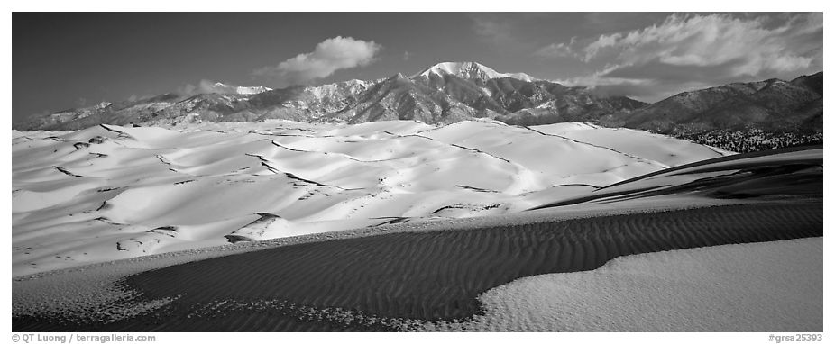 Landscape of snowy dunes and mountains. Great Sand Dunes National Park and Preserve (black and white)