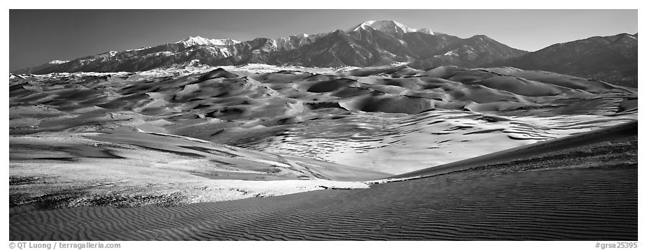 Landscape of sand dunes and mountains in winter. Great Sand Dunes National Park and Preserve (black and white)