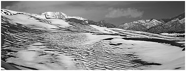 Melting snow on sand dunes. Great Sand Dunes National Park (Panoramic black and white)