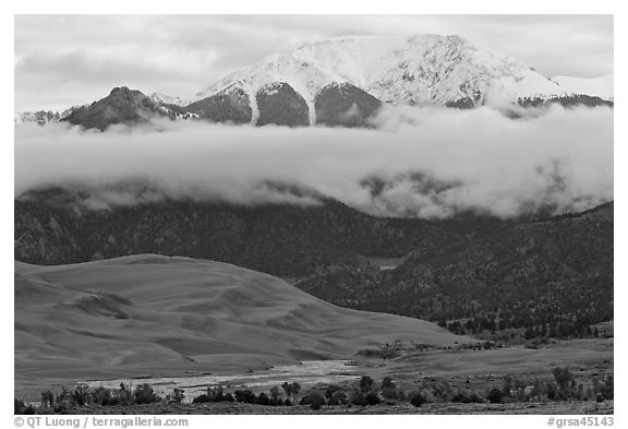 Dunes and Medano creek below snowy mountains. Great Sand Dunes National Park and Preserve (black and white)