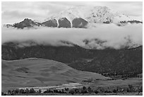 Dunes and Medano creek below snowy mountains. Great Sand Dunes National Park, Colorado, USA. (black and white)