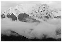 Snowy Sangre de Cristo Mountains above clouds. Great Sand Dunes National Park, Colorado, USA. (black and white)