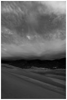 Dunes, moonlit clouds, and stars. Great Sand Dunes National Park, Colorado, USA. (black and white)