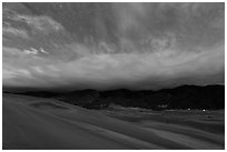 Dunes and clouds at night. Great Sand Dunes National Park, Colorado, USA. (black and white)