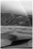 Rainbow over dune field. Great Sand Dunes National Park, Colorado, USA. (black and white)