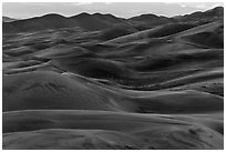 Dune ridges at dusk. Great Sand Dunes National Park, Colorado, USA. (black and white)