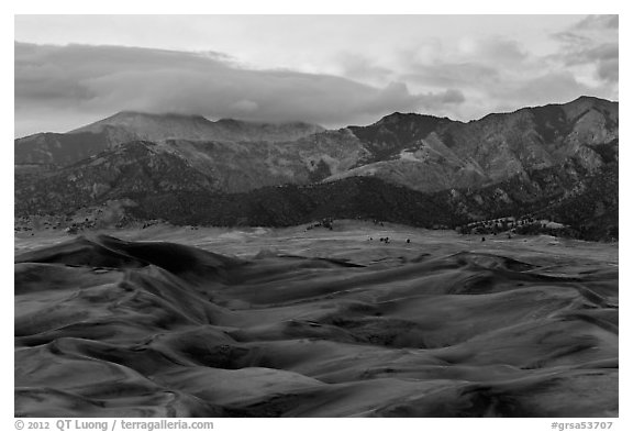 Dunes and mountains with fall colors at dusk. Great Sand Dunes National Park and Preserve (black and white)