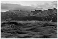 Dunes and mountains with fall colors at dusk. Great Sand Dunes National Park, Colorado, USA. (black and white)