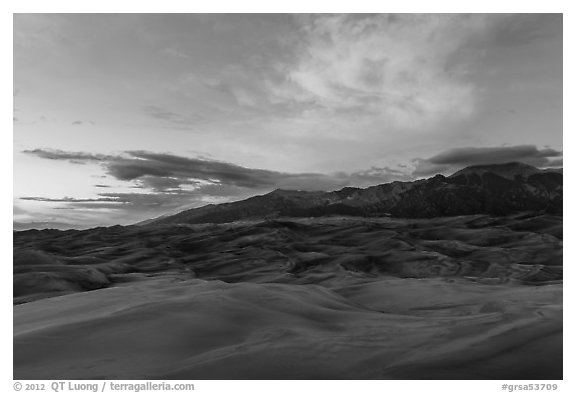 Dune field and Sangre de Cristo mountains with cloud lighted by sunset. Great Sand Dunes National Park and Preserve (black and white)
