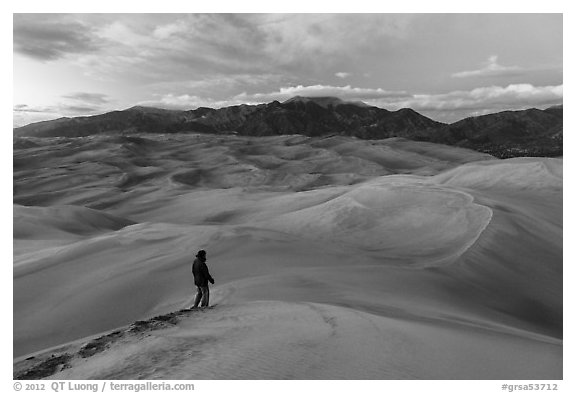 Visitor looking, dune field. Great Sand Dunes National Park and Preserve (black and white)