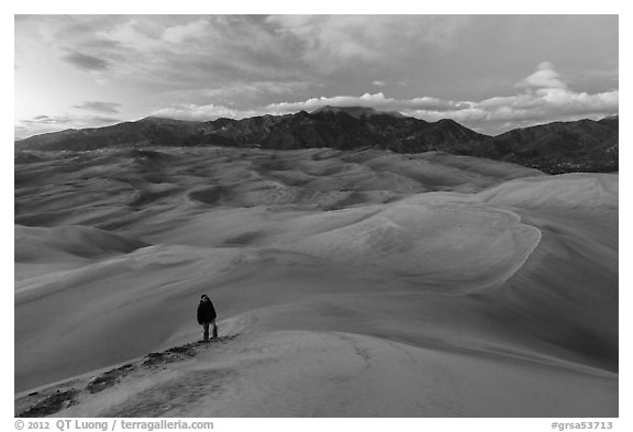 Hiker climbing high dune. Great Sand Dunes National Park and Preserve (black and white)